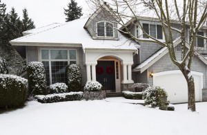 home exterior covered in snow