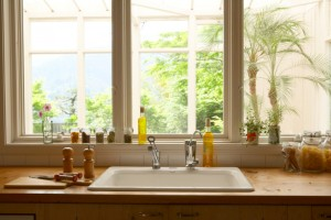 picture windows letting lots of natural light into the kitchen