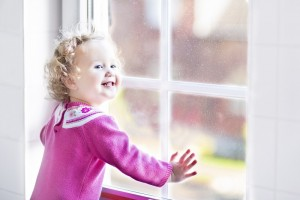 little girl enjoying replacement window during the holiday season